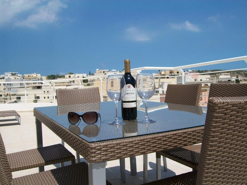 Enoy a glass of wine in the Maltese Sunshine