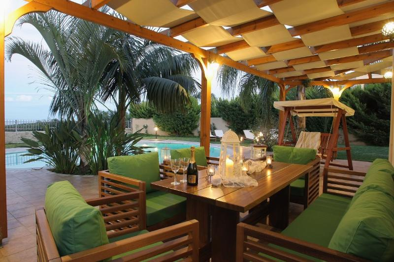 outdoor dining and relaxing aerea with Pool and seaview