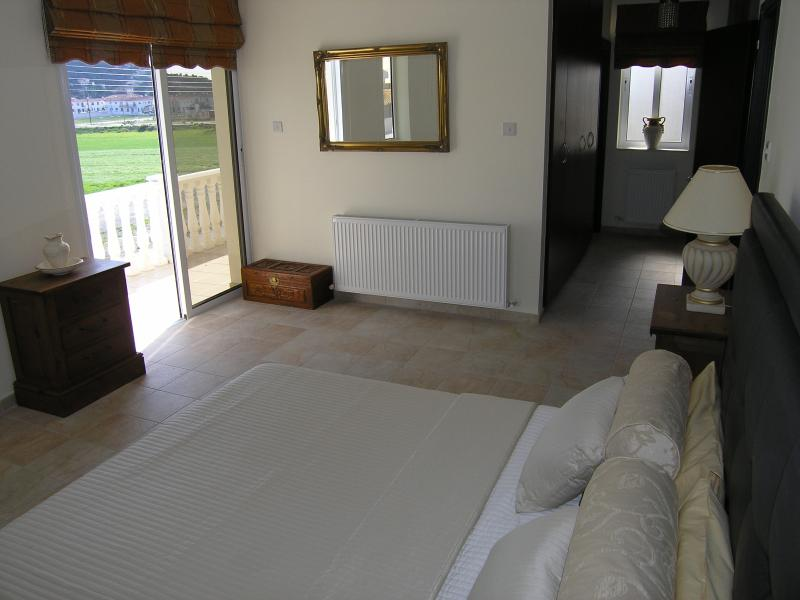 Master bedroom with balcony & dressing area.