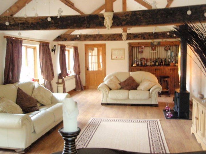 Beautiful, stylish lounge with bar & log fire