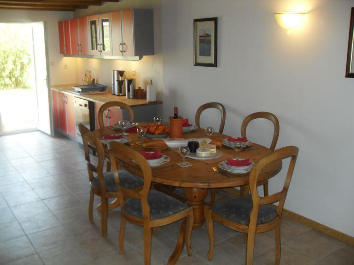 Part of dining and kitchen area