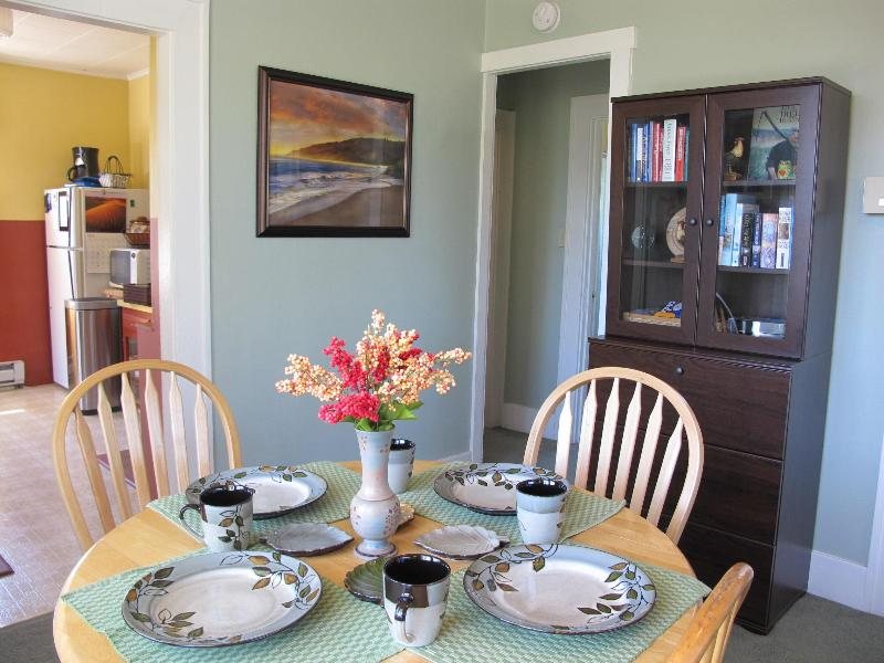 Dining area, with hutch in background with a collection of books for your reading pleasure.