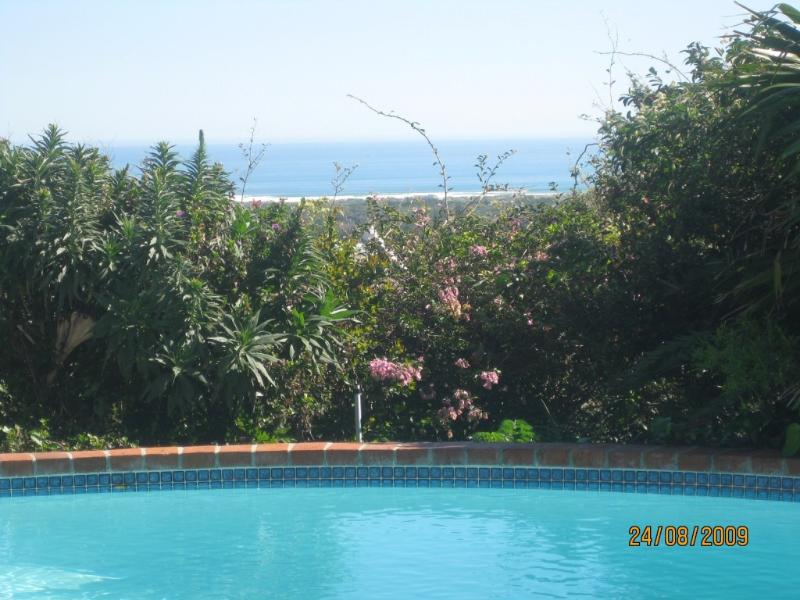 View of sea over pool