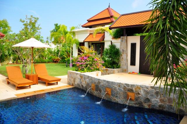 Pool, entrance Door with Garden Suite behind
