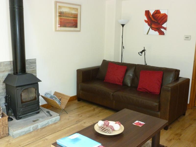 Living room, with one basket of logs provided for log burner.