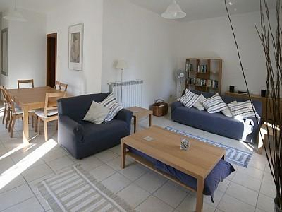 Relax in this spacious dining-sitting room.  Direct access to garden by patio doors.