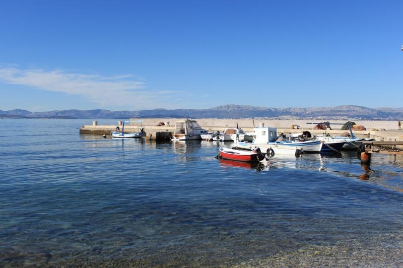 Little pier for local fishing boats and speed boat transfers