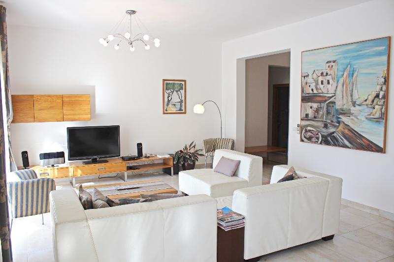 Living room features large TV (with internet) and home cinema (radio, DVD and CD player)