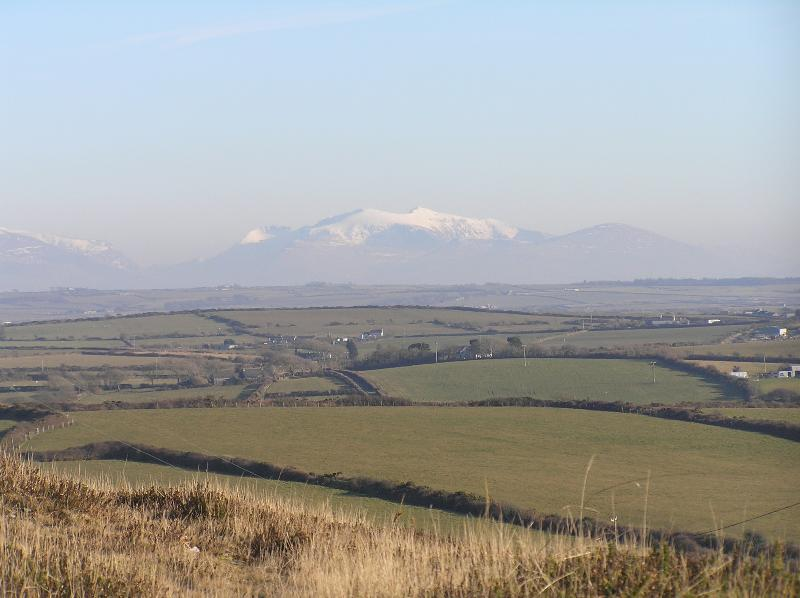 or walk up hill and enjoy the views to Snowdonia