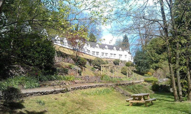 Another view of gardens and cottage