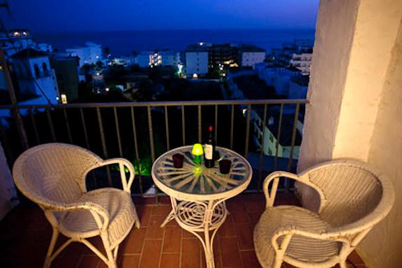 the balcony in the evening, with the view over the sea