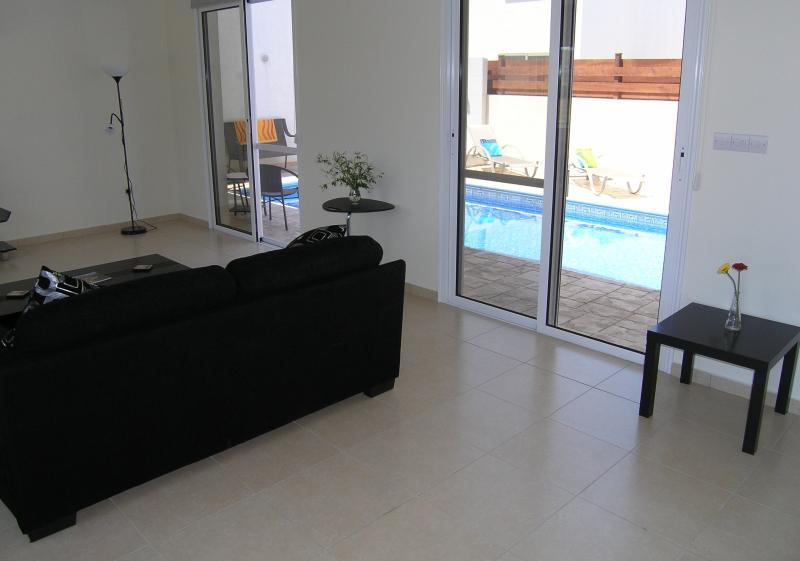 Comfortable lounge overlooks pool area.