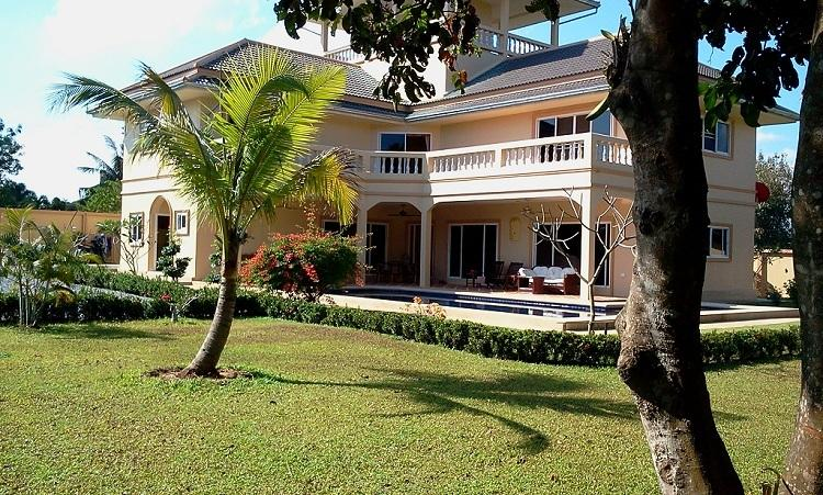 Main house view from tropical garden