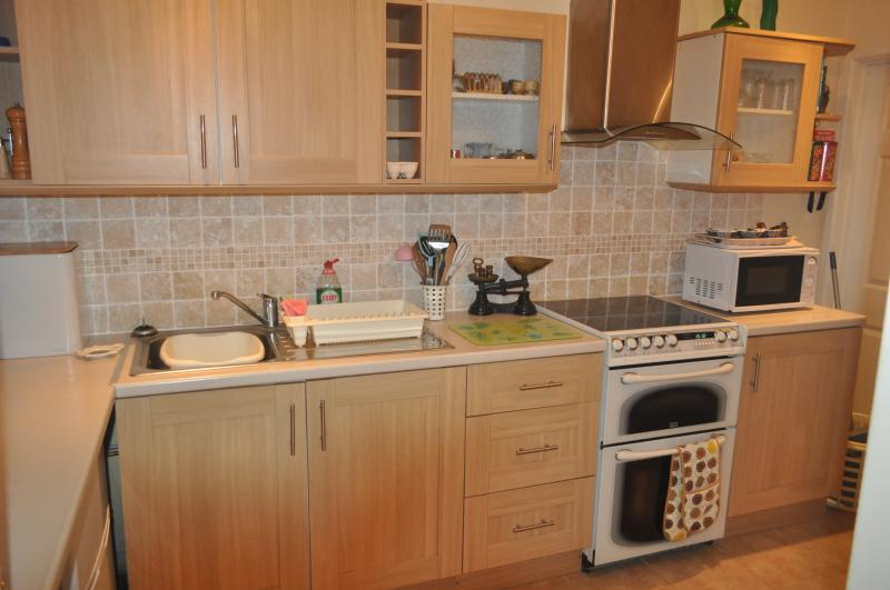 The kitchen is fully fitted, with a cooker, microwave, fridge freezer, saucepans and utensils.