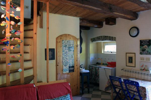Appartamento Michele: on the ground there is a living room with two chair beds, kitchenette and show