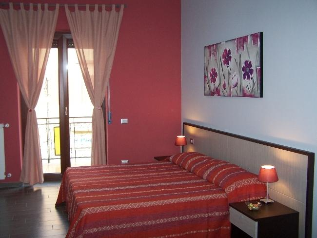 B&B Eco Pompeii, pink room with balcony.