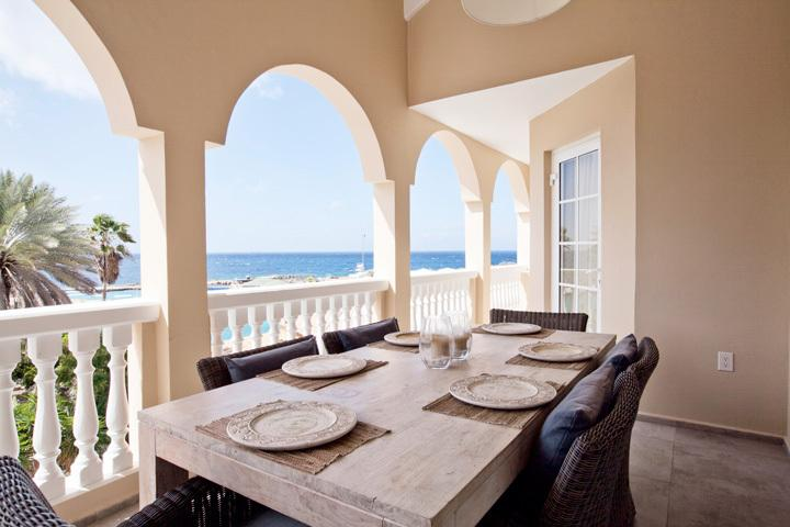 Spacious porch with dining table and room for six guests and of course, a stunning view!