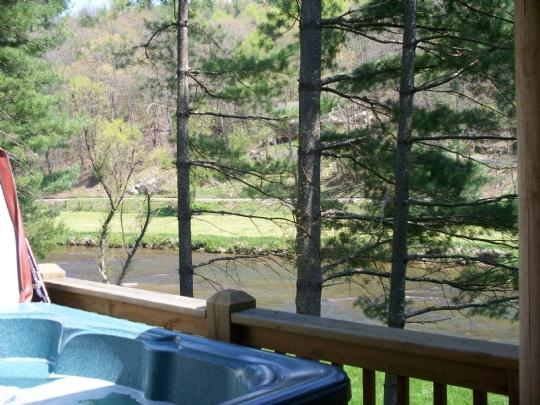 Unwind in the hot tub by the river