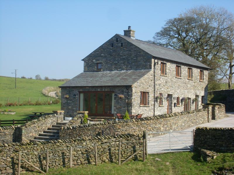 Barn Court Cottage is locates within Simgill Farm where Alpacas roam over it's many acres