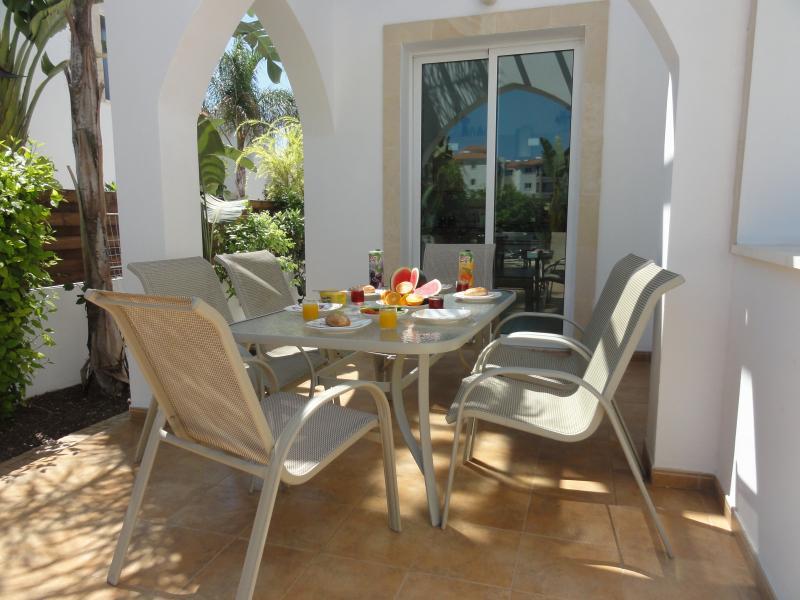 Relax and enjoy breakfast beside landscaped garden