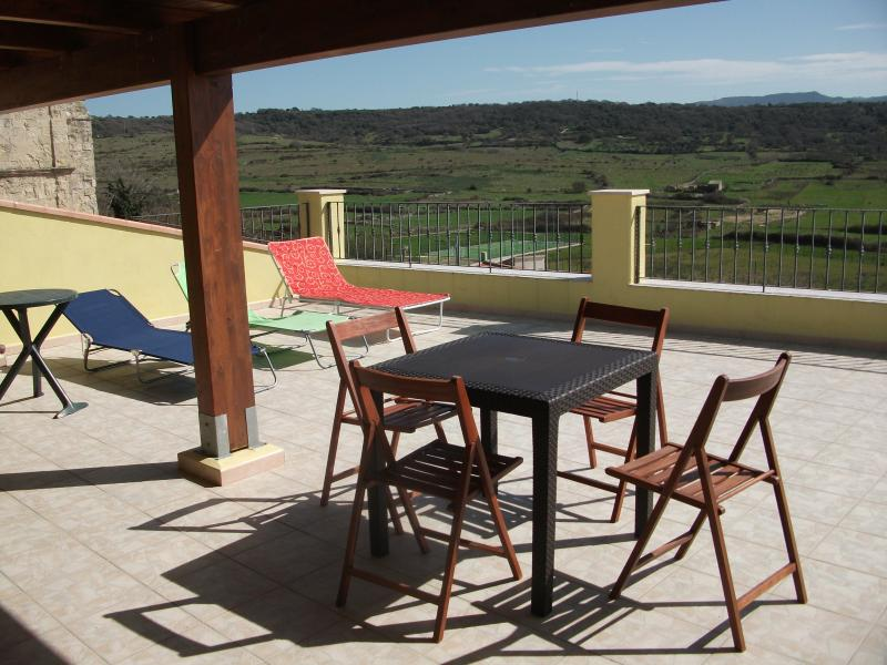 The spacious roof terrace has panoramic views across the valley