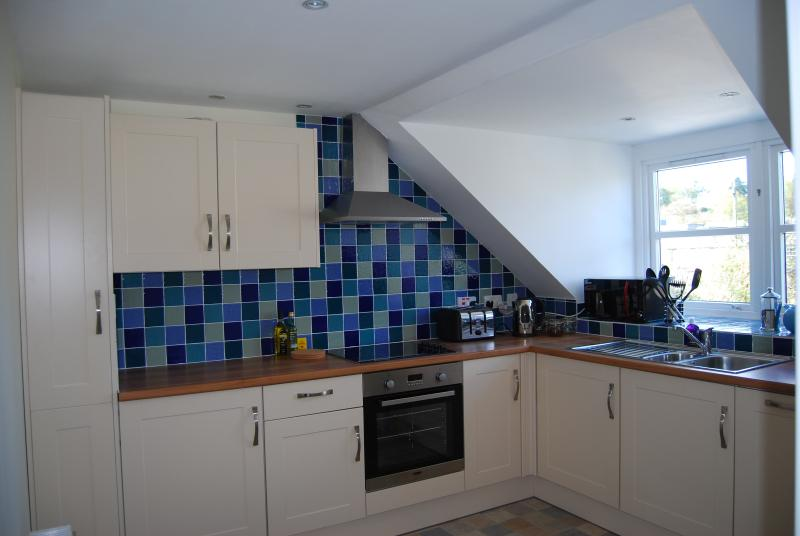 Kitchen which has a table