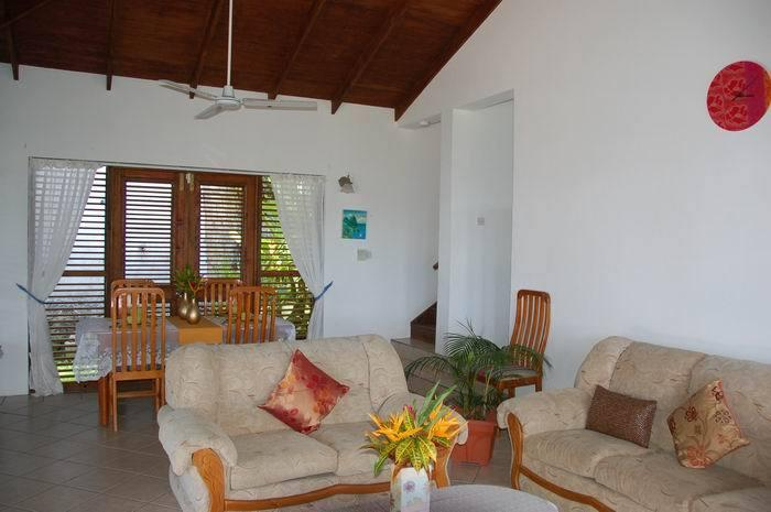 Spacious and bright lounge room which leads to the pool and kitchen area