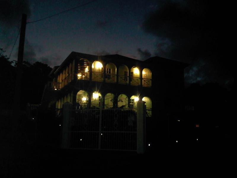 The house floodlit