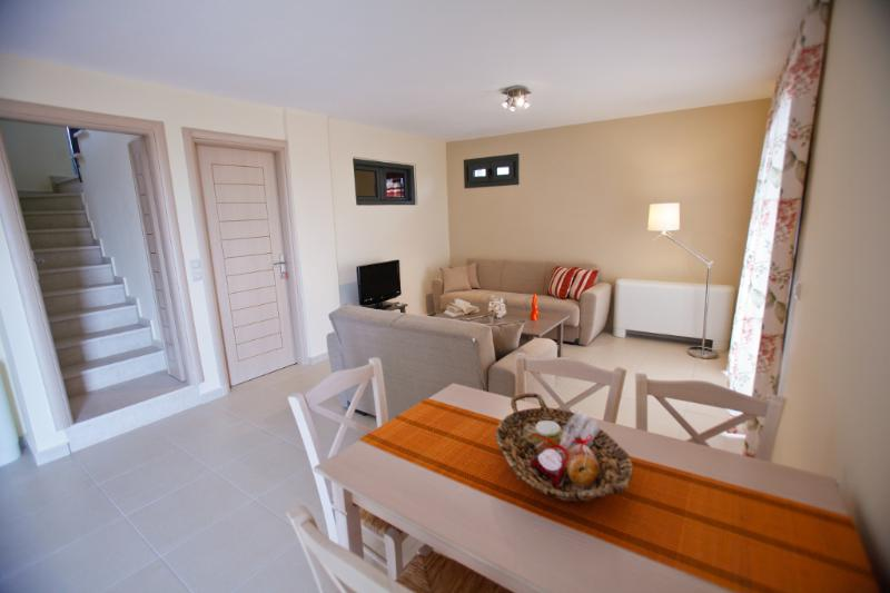 Living room leading to sunny front terrace