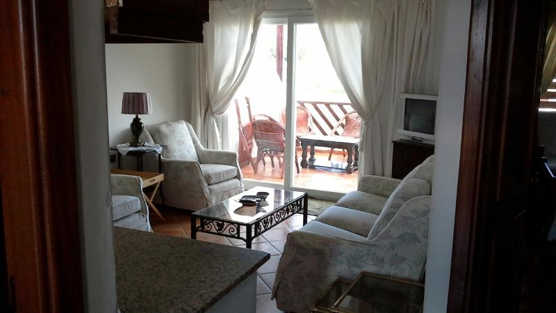 Relax on the  very comfortable sofas in the  air conditioned salon or