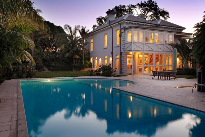 Pool and house at dusk