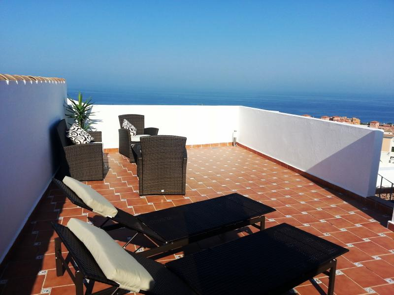 Relax on the private sun terrace with a glass of cava whilst admiring the stunning sea views