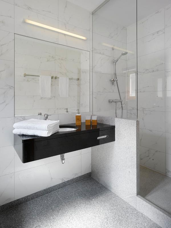 Elegant bathrooms at each villa  with walk-in shower and toiletries