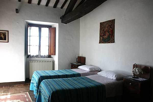 The bedroom with 2 single beds is a big room too