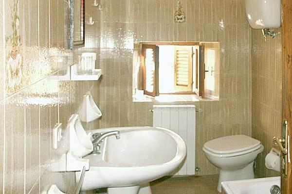 The upstairs bathroom with bath tub is a little dated but fully functional