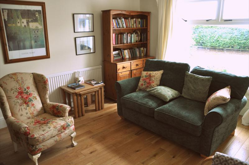 Sitting Room with large window, open fire, rocking chair and TV/DVD