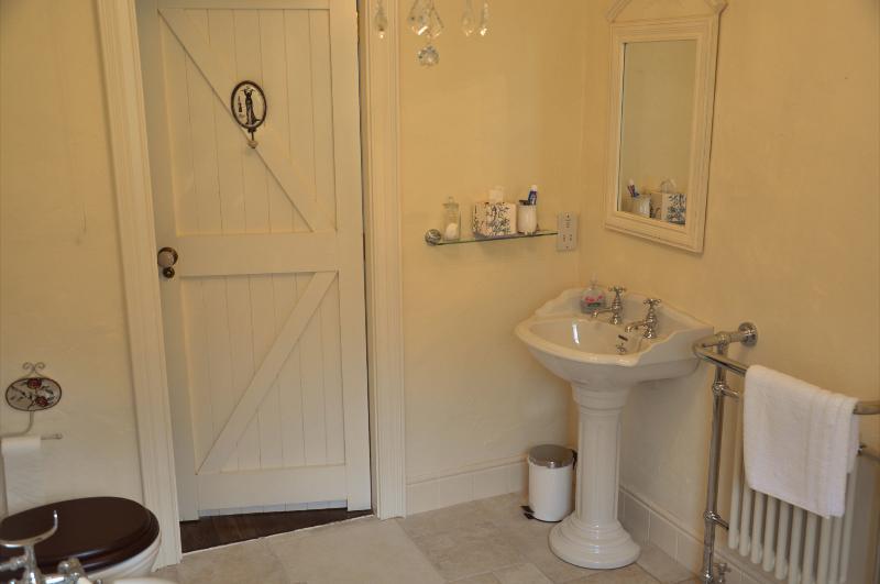 Bathroom, with heated towel rail, roll top bath and walk in power shower
