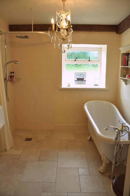 Bathroom with roll top bath and separate power shower