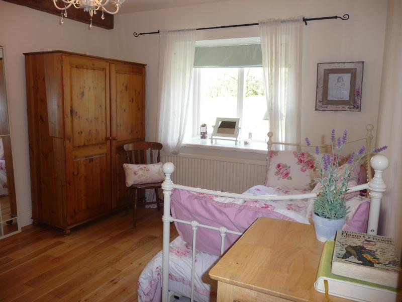 Second Bedroom with two single beds and pull out bed to give 3 single beds or a single and a double