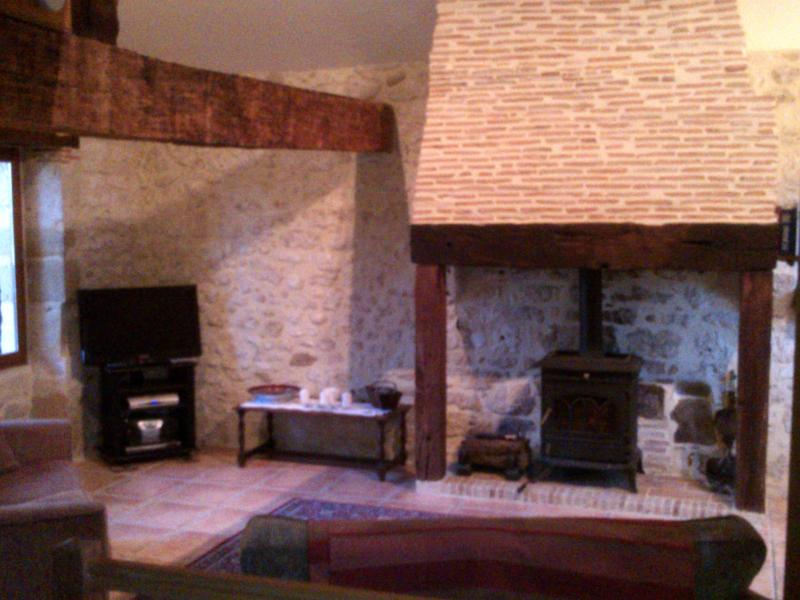 Spacious and comfortable lounge with woodburner and satellite TV