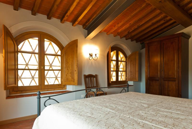 Bedroom 2 with traditional terracotta tiles in front of windows to shade your room
