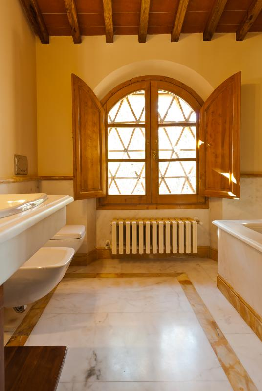 Complete marble bathroom with bath