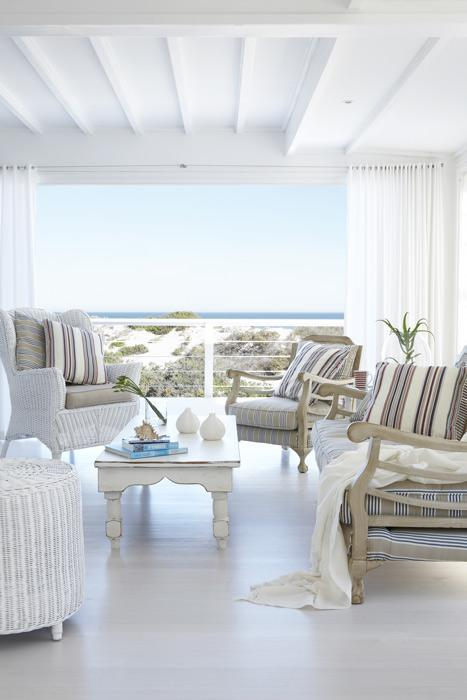 Lime washed tasmanian oak floors with comfortably upholstered furniture.
