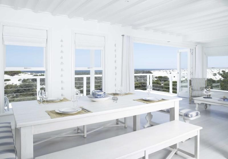 The dining table on the middle floor with seating for 8 people.