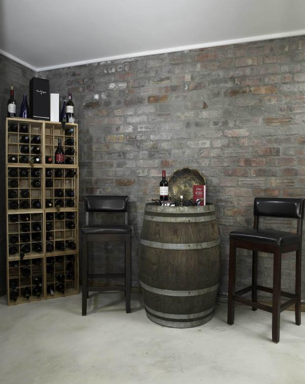 The rustic, private cellar on the lower floor with a music centre.