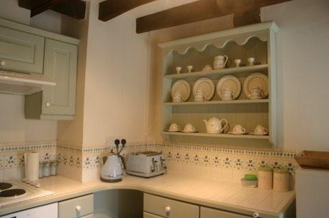 A charming and well equipped shaker style kitchen, fun to be in and to cook in.