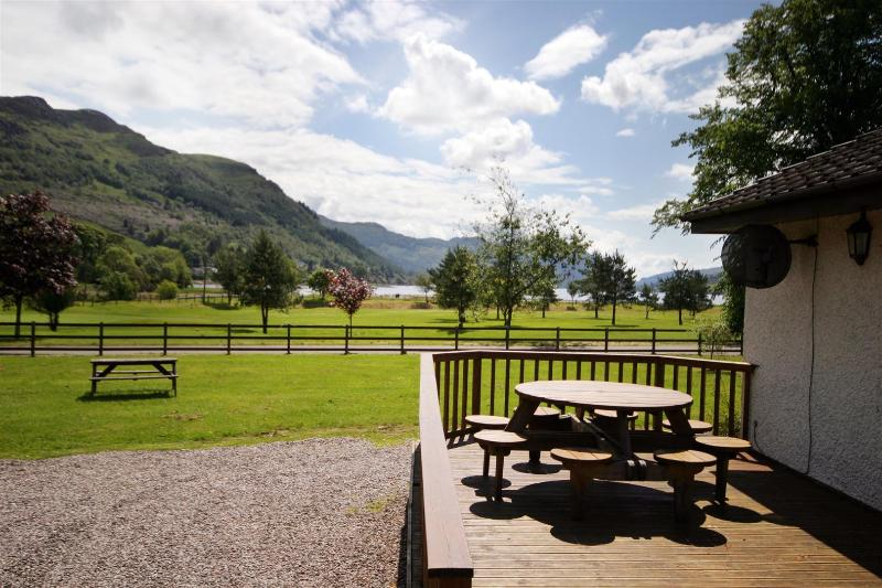 Deck with seating for 8 and views over the golf course to Loch Goil.
