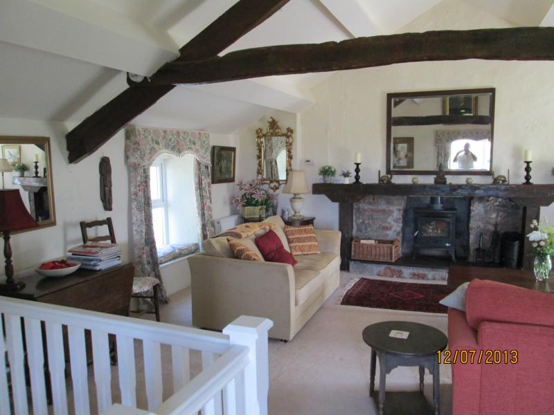 Large sitting room upstairs with my family furniture to make you feel at home. Great sofa bed too !