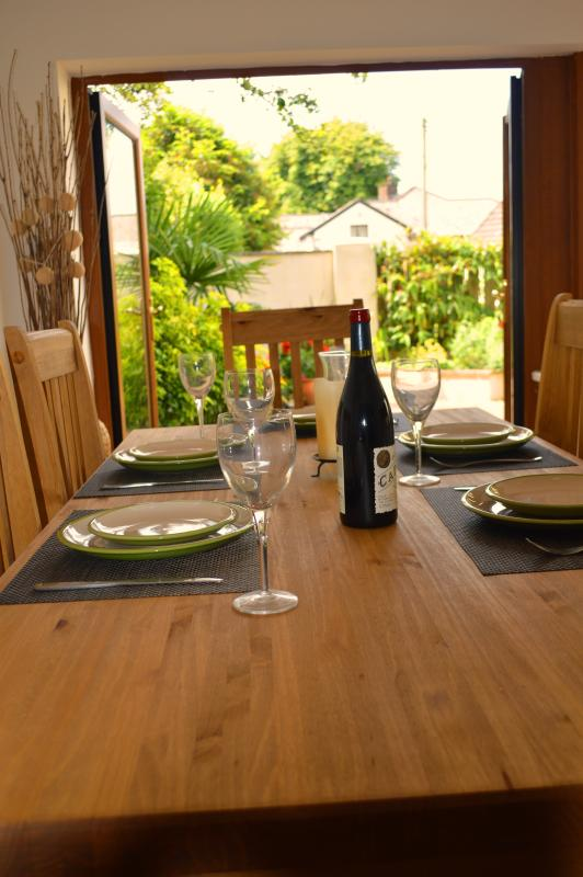 Patio doors open from the dining area to the pretty enclosed terrace garden.