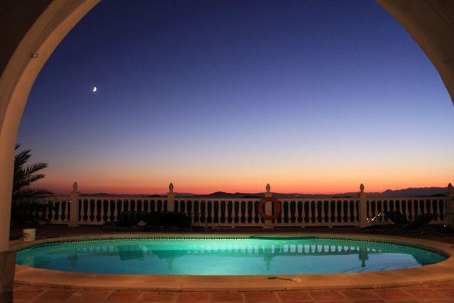 sunset and pool at night